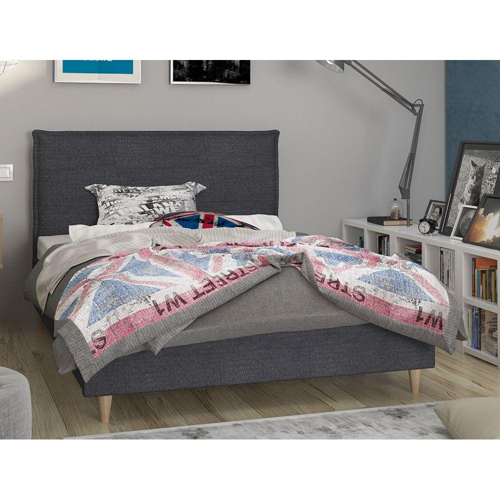 Κρεβάτι ημίδιπλο επενδυμένο με ύφασμα σε σκούρο γκρι χρώμα σε ένα υπνοδωμάτιο